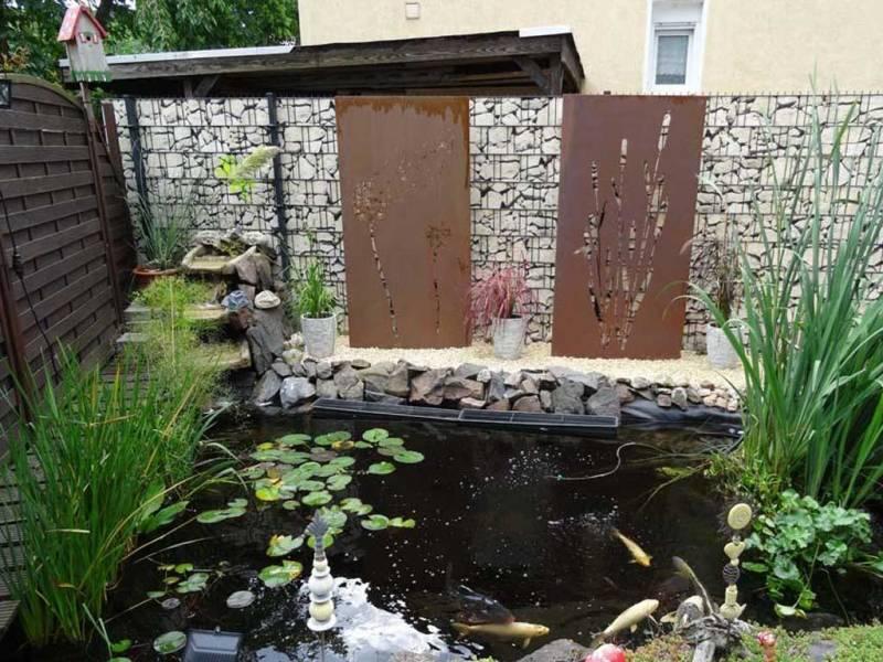 Zaun Sichtschutz Steine weiß Teich
